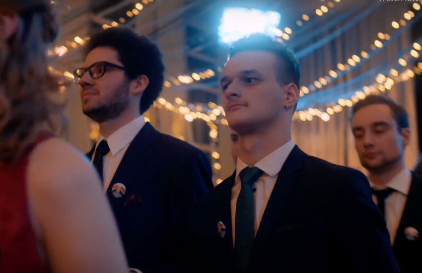 Two boys walk hand-in-hand at Poland's first LGBTI-inclusive prom
