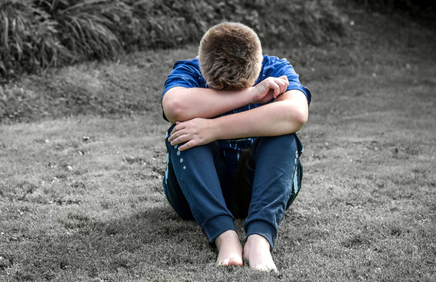 Suicide - A photo of a boy crying into his arms