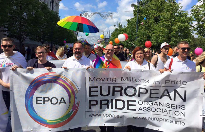 Steve Taylor marching at a Pride event.