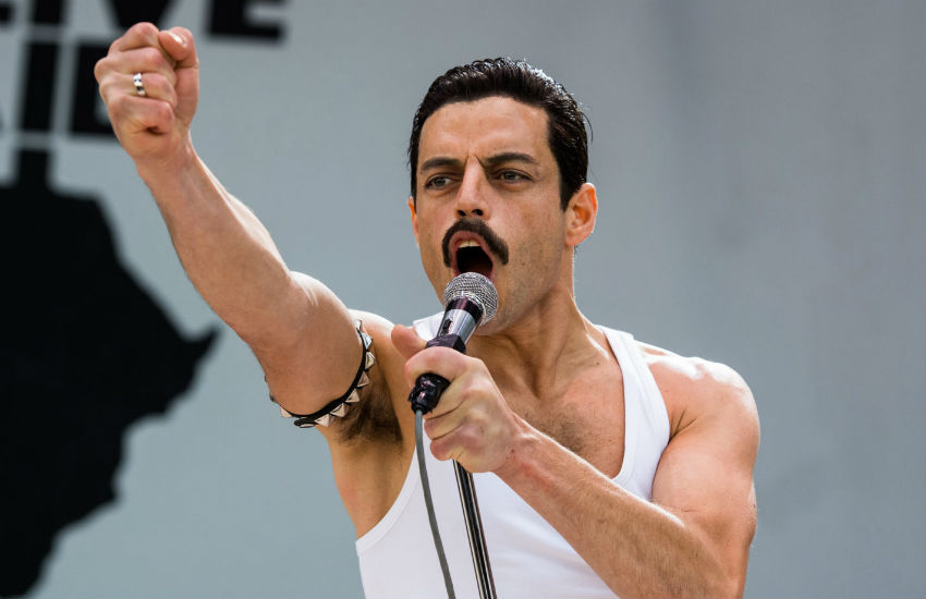 Rami Malek as Freddie Mercury, performing at Live Aid in the movie, Bohemian Rhapsody