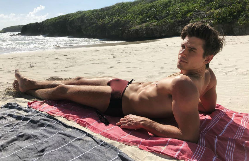 Queer Eye's Antoni Porowski in a speedo on the beach
