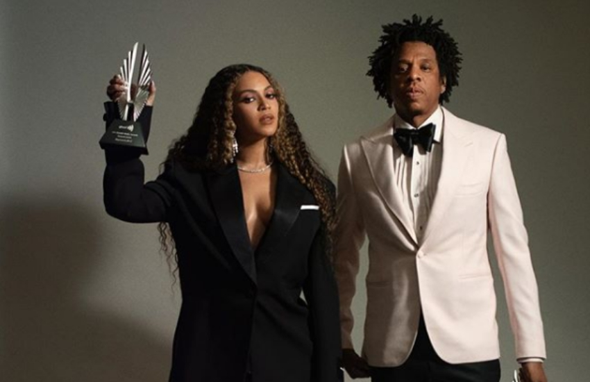 The pop Royal Family, Beyonce and Jay-Z, posing in an Instagram photo, holding their awards