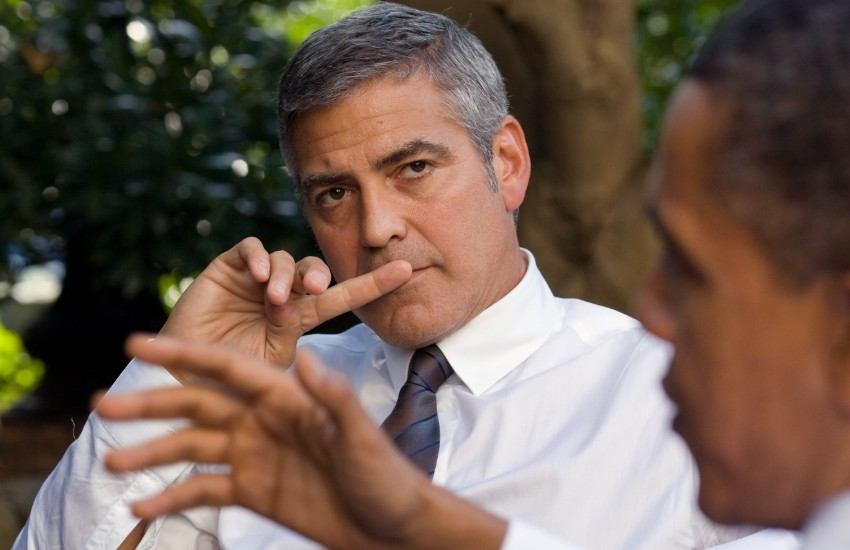 George Clooney speaking to Barack Obama