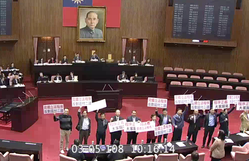 Opposition lawmakers protest same-sex marriage bill in country's parliament (Photo: Legislative Yuan Live Feed)