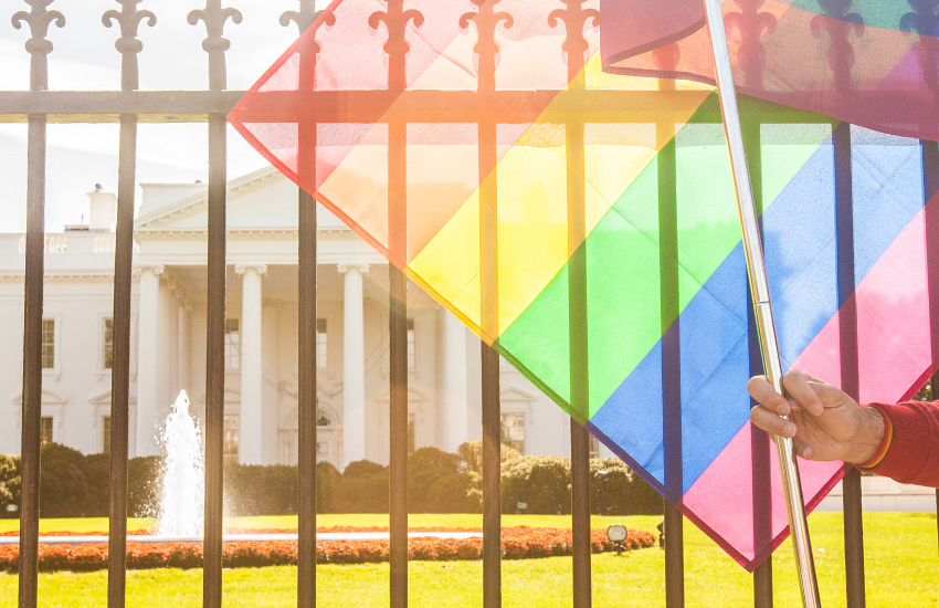 A LGBTI pride flag being planted outside the White House