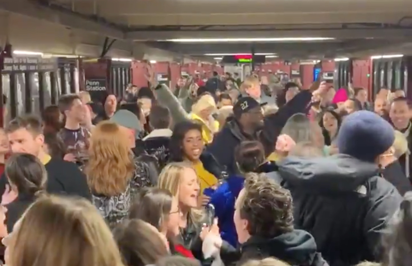 Happy fans dancing to LGBTI pop icon, Robyn's Dancing On My Own, in Penn Station, New York City