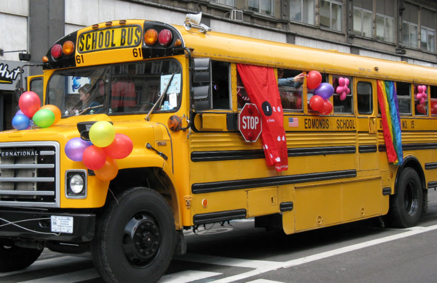 A school bus with rainbow decorations