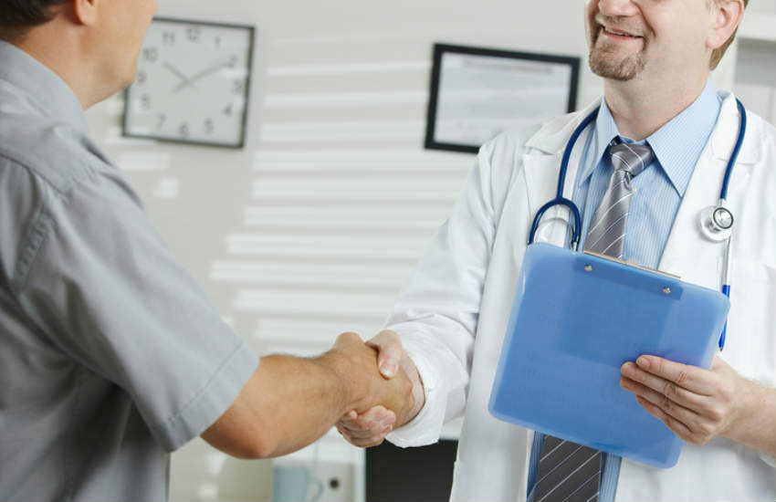 Doctor greeting a patient.