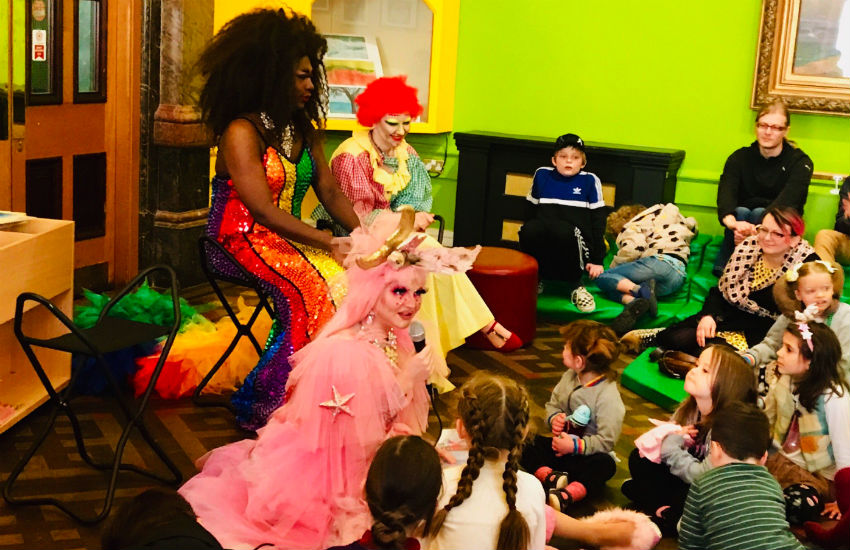 Are you sitting comfortably? Children listen-in to Drag Story Time. Photo: @CarlDurose Twitter