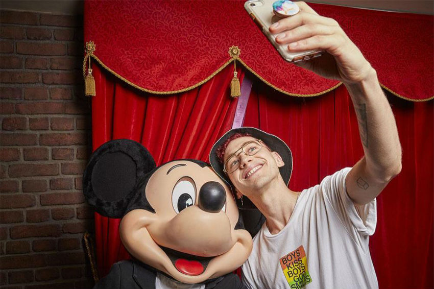 Olly Alexander from Years & Years hangs out with Mickey Mouse | Years & Years/Disneyland Paris