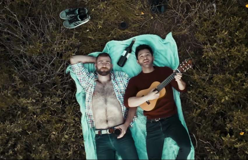 Singapore singer Wils (right) and his lover in the music video for Open Up Babe