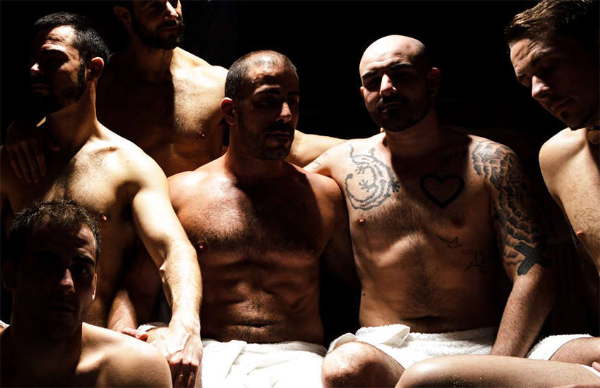 Gay men in a promotion photo for Chariots sauna in London