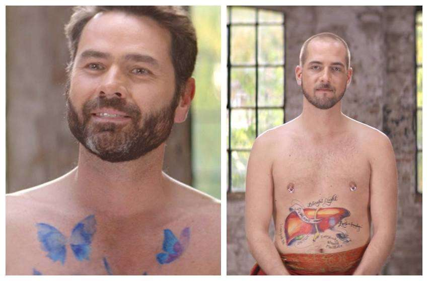 two topless men with paint on their chests