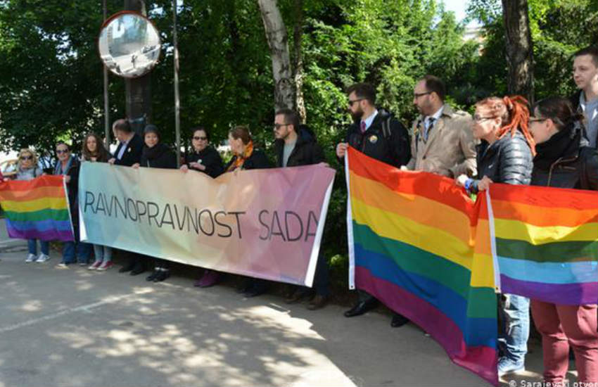 LGBTI activists holindg a banner reading 'Equality now'.