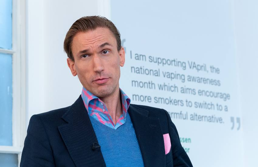 Dr Christian Jessen speaking, he is wearing a dark blazer and blue jumper