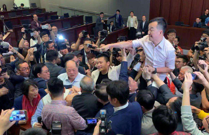 Hong Kong's only openly-gay politician, Ray Chan (in pink shirt) (Photo: Twitter)
