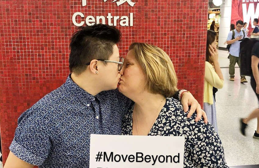 LGBTI rights campaigners Abby Lee and Betty Grisoni kiss protest in a Hong Kong MTR station (Photo: Facebook)