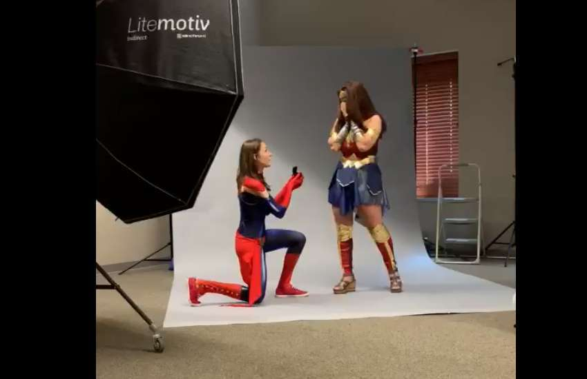 Girlfriend proposes to her girlfriend dressed as Captain Marvel and Wonder Woman