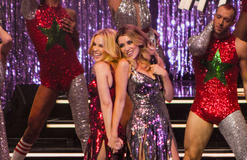 Kylie Minogue (left) with sister Dannii (right)