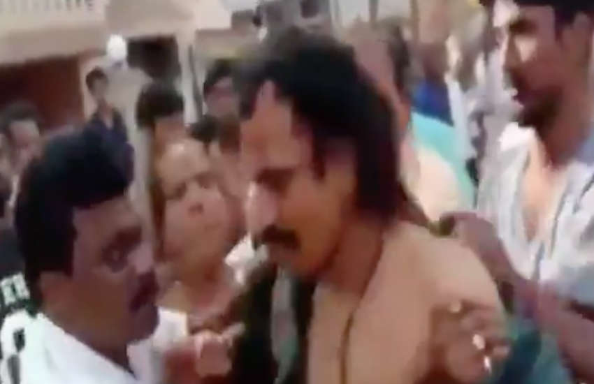 The mob ripped off the priest's clothes and cut his hair (Photo: YouTube)