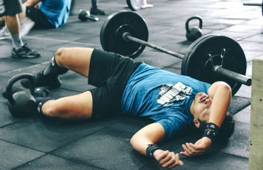 Stock photo of a male gym-goer on the floor