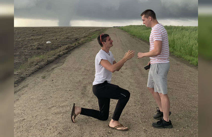 Meteorologist Joey Krastel gets down on one knee before boyfriend Chris Scott