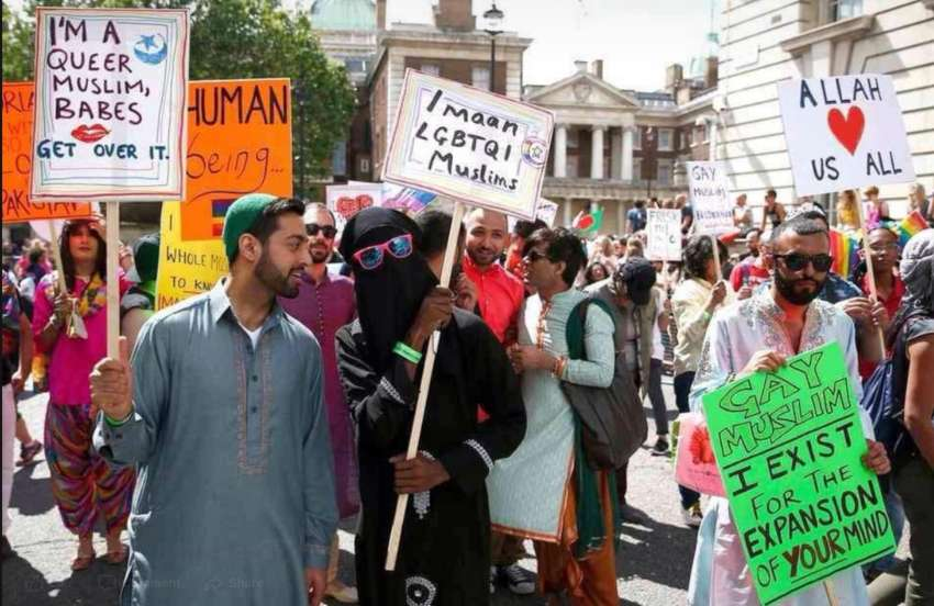 lgbti muslims at a pride parade holding placards