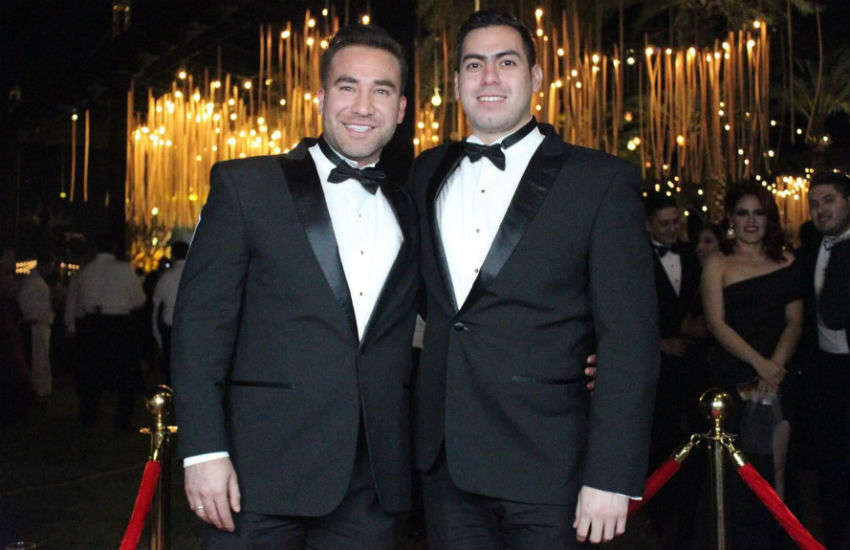 Rubén Veliz and Edwin Contreras were turned away from the restaurant for holding hands