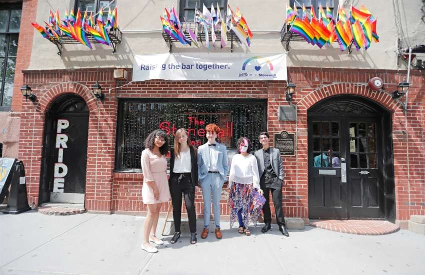 The recipients of the Yankees Stonewall scholarships standing outside stonewall inn