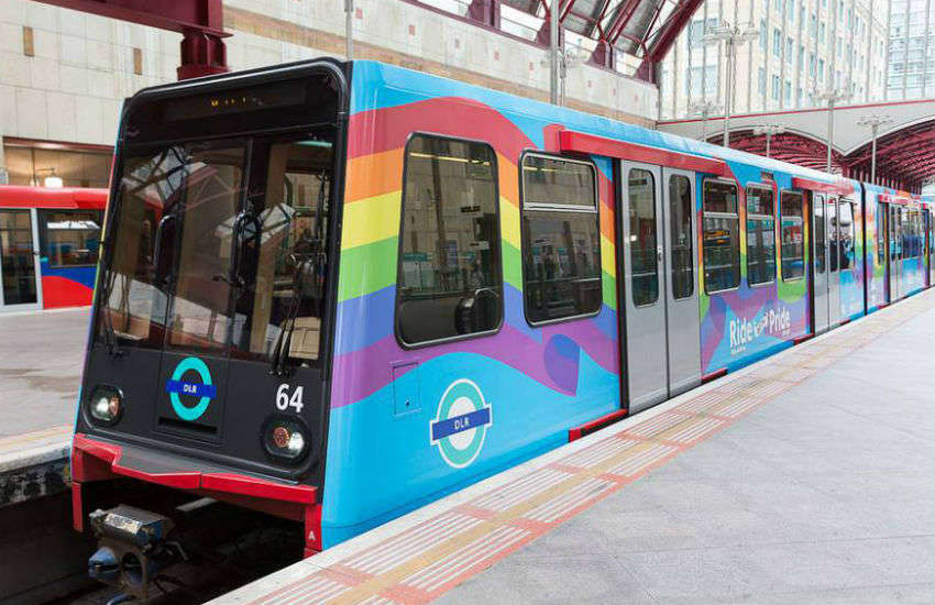 A Docklands Light Railway train, operated by TfL, decorated in rainbow colors for Pride in 2015