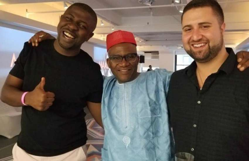 Gay Nigerian, John Adewoye [middle] and friends after he received the Unsung Heroes Award earlier this month | Photo: Facebook