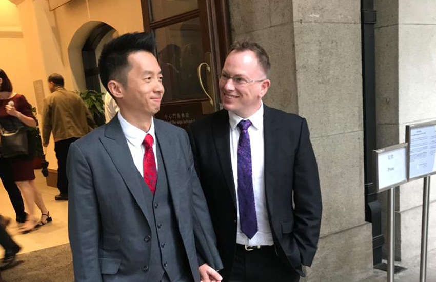 Angus Leung and Scott Adams outside court at a previous hearing (Photo: Facebook)