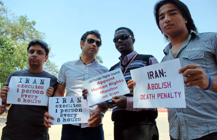 Men protesting the gay death penalty in Iran