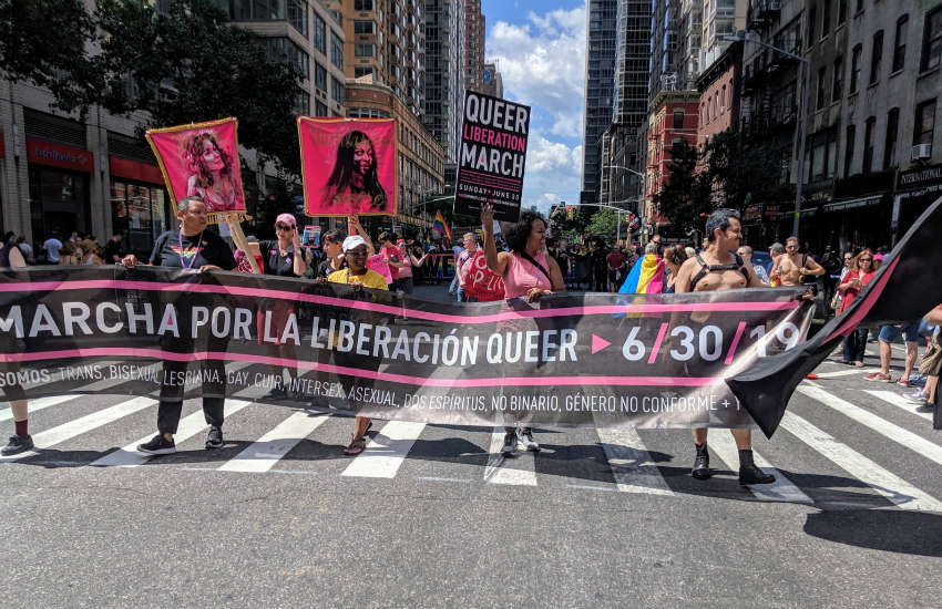 The banner leading the Queer Liberation March