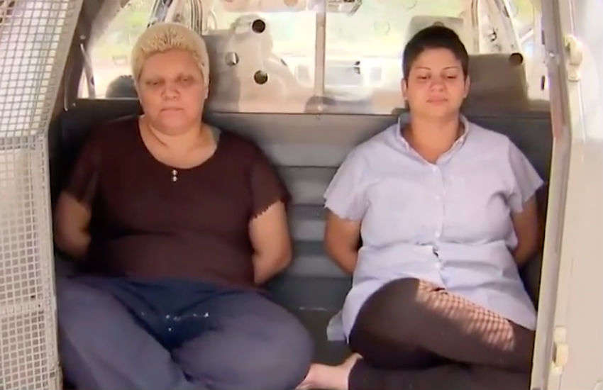 Rosana Cândido and Kacyla Pessoa, pictured here in the back of a police car, have admitted killing Rhuan Maycon da Silva Castro