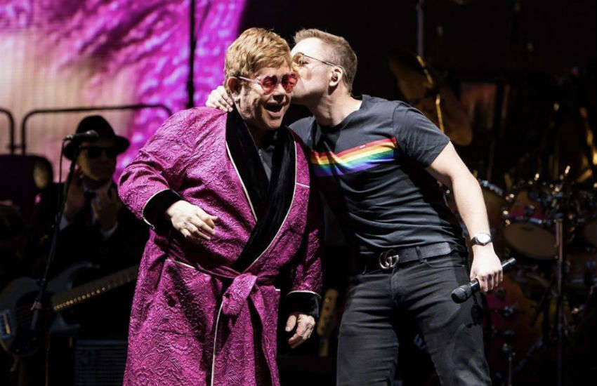 Elton John is kissed by Taron Egerton on stage in Brighton, England
