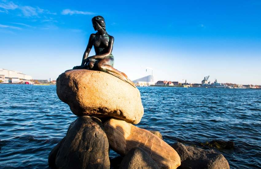 A statue dedicated to The Little Mermaid by Hans Christian Anderson in Copenhagen, Denmark