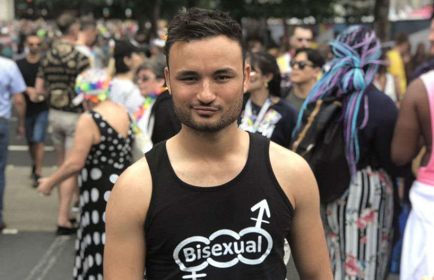 Lewis Oakley wears a bisexual t-shirt at Pride in London | Photo: Supplied