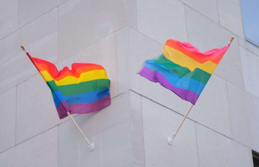 Pride flags outside the Romney building in Michigan in June