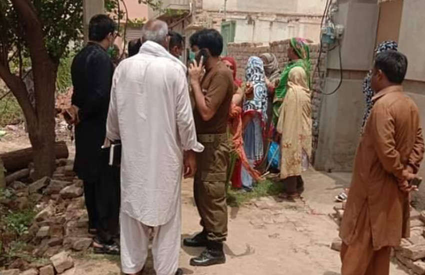 Police and residents gather outside the house where the two women were found in Pakistan (Photo: Facebook / Trans Action Pakistan)