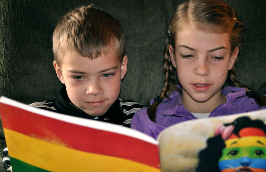 Kids reading a book together