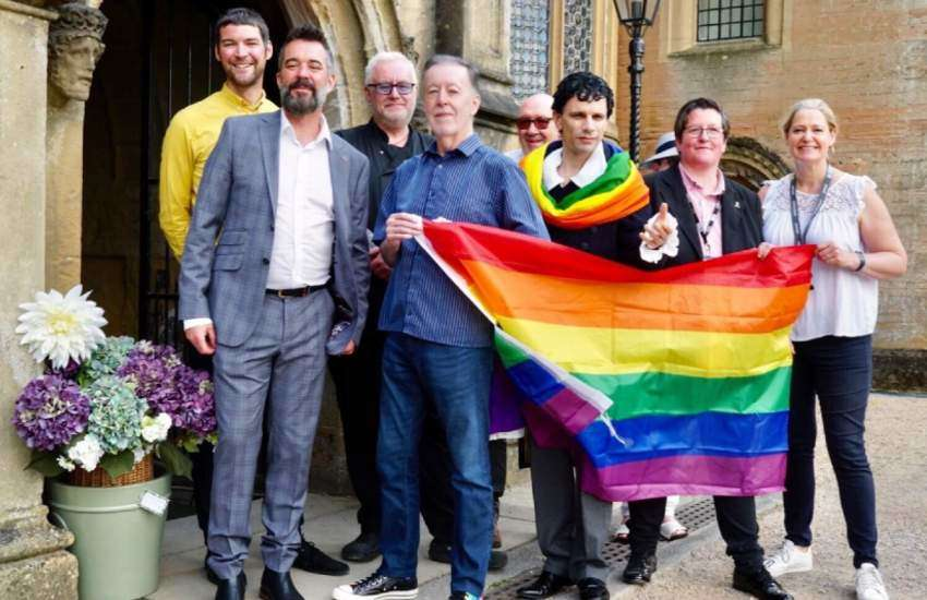 An impersonator for Romantic author Lord Byron raised a rainbow flag at the poet's ancestral home in Nottinghamshire