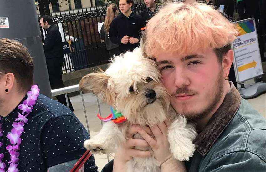 Sam Plant, who is bi, with his sister's dog during Edinburgh Pride 2019 | Picture: Instagram (@samplant.mp3)