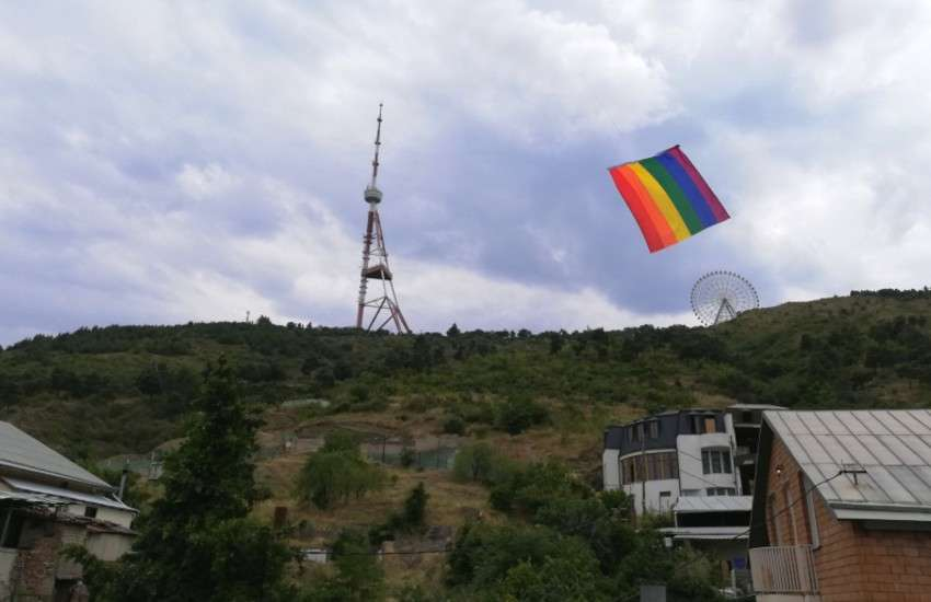 A rainbow flag flying across the sky of Tbilisi to protest the cancellation of Tbilisi Pride