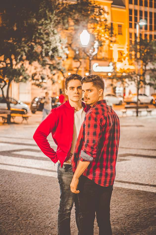 Two young men in a town square.