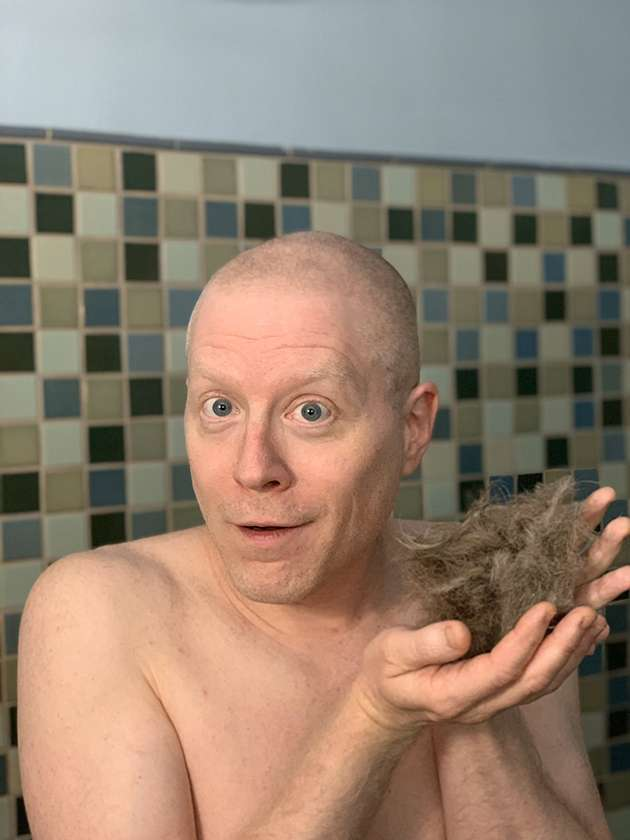 Anthony Rapp shows off his shaved head.