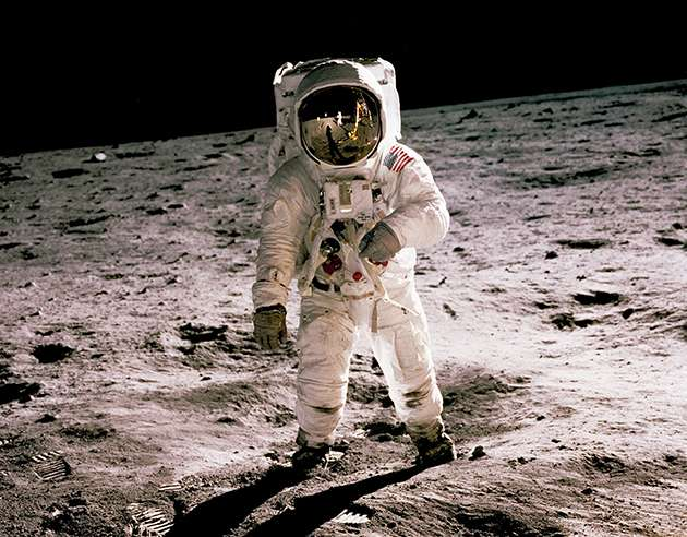 Man in spacesuit on the Moon.
