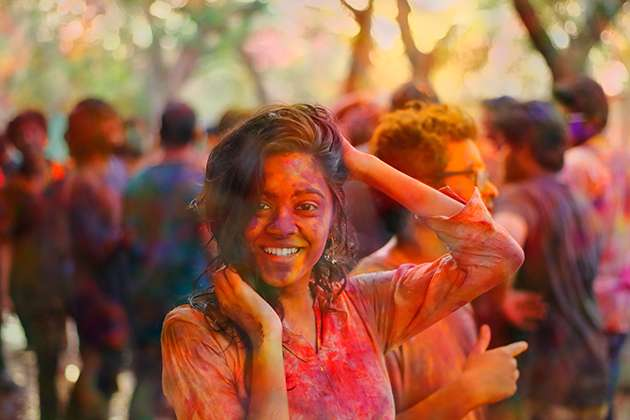 A woman covered in colored dye in Hyderabad.