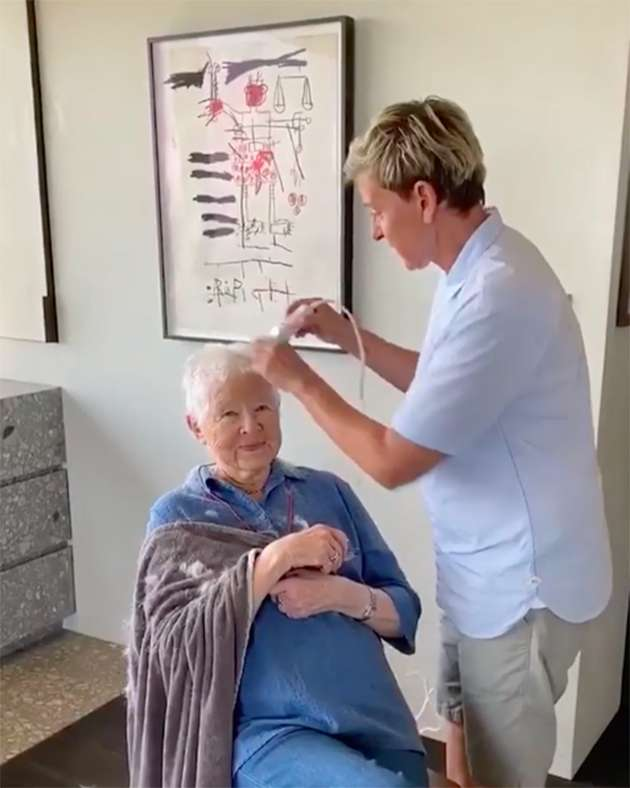 Ellen DeGeneres cutting her mom Betty's hair.