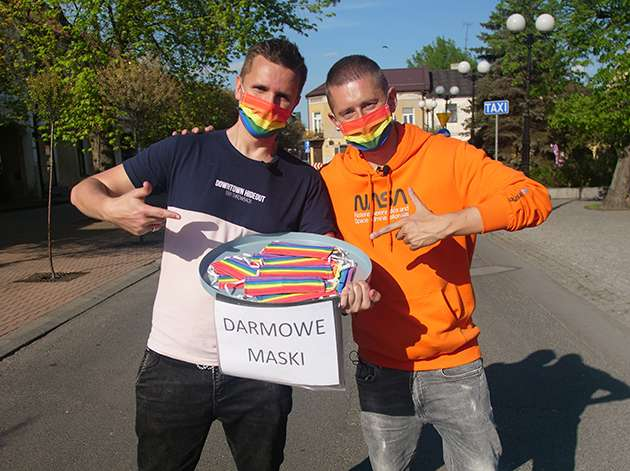 Jakub and Dawid handing out free rainbow masks.